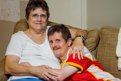 man with disorder hugging his mom